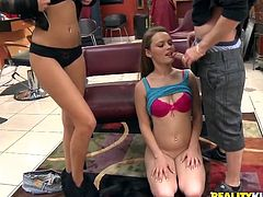 At the start voluptuous white babe gets her shaved meaty snatch licked by her gorgeous black haired girlfriend. Then both chicks kneel down and give terrific blowjob sucking one thick cock.