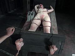 This petite and sexy chick Justine Joli is going to be fucked up all over! She gets tied up and then her mistress starts covering her body with hot wax!