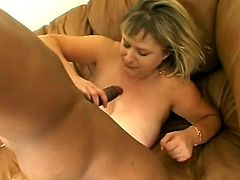 This mature amateur woman is getting some interracial love from this young black stud and his big black cock that may have just made her 10 years younger.