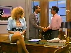 Busty secretary blonde is ready to serve her boss at the highest level. He pokes her right on the table and examines her puffy pussy with fingers.