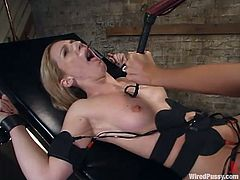Two hot blondes Gen Padova and Kimberly Kane are having a good time in a basement. Gwen ties Kim up and humiliates her before pounding her nice pussy with a dildo.