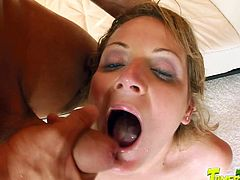 Watch this slutty blonde swallow two big loads of cum in a hardcore scene where she's fucked silly by two big cocks in a threesome.