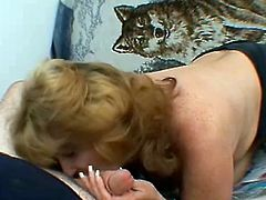 Salacious blonde mom Raven is having fun with some guy in a bedroom. She strips and shows her body to the dude and then rubs his weiner till it explodes with jizz.