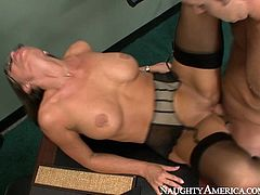 Appetizing nympho in sexy black stockings wants her lover's tongue in her pussy. She spreads her legs wide indicating how bad she wants him to lick her snatch. Horny stud licks it greedily. Then he fucks her pussy in missionary position.