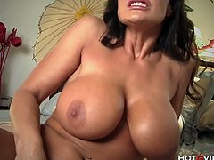 Lisa Ann is a classy and incredibly hot milf. She strips off her blue lingerie, showing off her massive jugs and nicely-shaped ass. She tries HotGVibe on her pussy and gives herself an orgasm.