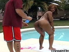 Busty black chick called Melodee is having fun with some guy on the poolside. She allows him to oil and rub her ass, then gives him a great blowjob and they fuck in cowgirl and other positions.