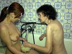 Tall and slender brunette teen helps her time worn granny to take a bath. Both bitches get naked and start playing with each other's tits.