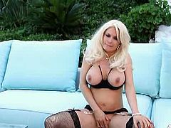 Diamond Foxxx is a nasty and alluring blonde milf who looks very hot in black lingerie. Watch her flaunting her big round tits and sexy ass in the backyard while rubbing her shaved slit.