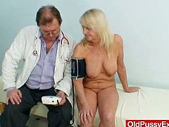 Busty and blonde mommy Dorota spreads her legs and the doctor start checking her hairy vagina! He stretches that flabby cunt with a vaginal speculum first!