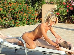 These two babes were doing some nude sunbathing when they decided to oil each other up and trade sensual full body massages.