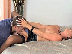 Sexy dark-haired mom wearing black stockings allows a horny stud to eat her pussy. Then they fuck in side-by-side position and doggy style and seem to be unable to stop.