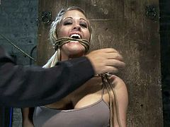 Submissive blonde girl gets tied up and gagged by a guy. Then she gets whipped and clothespinned. In addition this babe gets her pussy toyed with a vibrator.