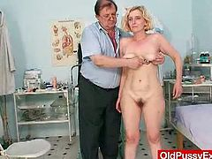 Tamara is an aged blonde mother who needs to get a full body examination. The doctor starts with her big boobs and then he continues with her flexible pussy.
