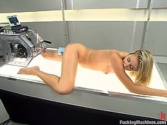 Amazing blonde babe takes her clothes off and lies down. She spreads her sexy legs and gets both her holes drilled by the fucking machine.