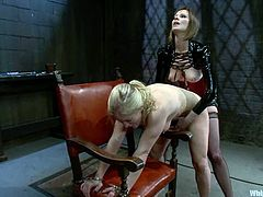 Hot blonde chick gets her boobs and belly clothespinned by brunette mistress. Then she also gets suspended and toyed rough.