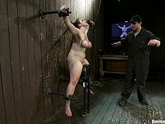 Chubby well-endowed mom Bella Rossi gets chained and tormented by some dude in a basement. Then the man makes Bella ride a fucking machine and the bitch seems to enjoy it much.