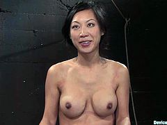 Tia Ling enjoys a toy in her Asian pussy in terrific BDSM clip