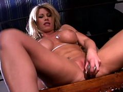 This outstanding babe with huge round boobs and amazing body is fingering and toying her narrow pussy. Enjoy watching this amazing blonde hoe.