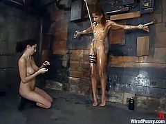 This sexy exotic chick is getting tortured in this bondage session but not a bad torture, just some kinky stuff by another kinky girl.
