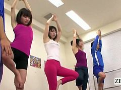 Japanese students of yoga line up in a small studio as a spandex clad instructor with an out of place gravelly voice and a massively apparent erection provides one of his pert stretching students instructions from close range as he audaciously r