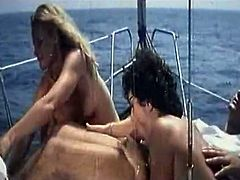 One guy took two gorgeous busty babes on a boat ride. Hotties got naked and started sucking dude's fat juicy cock together.