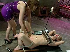 Long-haired blonde Carolyn Reese allows insatiable dominatrix Maitresse Madeline to tie her up in a basement. Madeline makes Reese lick her snatch and then fucks her hard with a strapon.