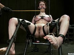 Two of her dommes circle around her trapped body, doing some nasty and painful things to her. One of these things is a massive twitching!
