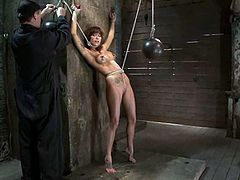 Sexy brunette girl gets undressed and then tied up. Some guy tortures her tits with claws and then he toys her vagina.