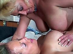 Take a good look on these two beautiful lesbo chicks, one older and one younger. Watch as they start pleasuring their horny twats with their tongues and toys.