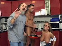 Sizzling blonde mom is having fun with two dudes in the kitchen. She shows her massive natural tits to the dudes and then one of the guys suggests the milf to suck his hard cock.