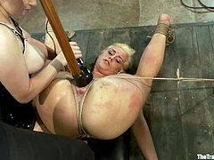 Naughty blonde chick gets tied up and tortured with clothespins by another blonde. After that Tara gets her pussy fisted and toyed.