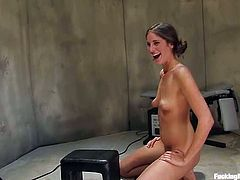 Pretty brown-haired chick Kara Dax is having fun in a basement. She rubs her hot pussy ardently and then gets it smashed by a fucking machine from behind.