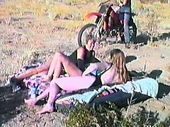 A few bitches are having fun with their BFs in a field. The girls show their cock-sucking skills to the guys and then get fucked in cowgirl and other positions.