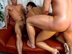 Brunette bombshell Simony Diamond is having fun with two studs indoors. She admires the dudes with her cock-sucking abilities and then gets double penetrated and moans loudly with pleasure.