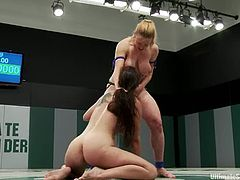 Bryn Blayne is having a wrestling match with busty blonde lesbian called Darling. The girls struggle with each other on the ring and then the blonde fucks the brunette with a strapon.