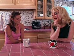 Porner Premium brings you an amazing free porn video where you can see how the vicious blonde milf Nina Hartley and a hot brunette teen go lesbo together in the kitchen.