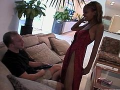Brandon had enough with his Hispanic chick and wants some black pussy! Miss Lacey is just what he was looking for and damn, she's hot! The ebony whore approaches him wearing her sexy dress and the guy begins to delight with her. Seeing her so hot, even his girl joins in and licks her bald, juicy black pussy.