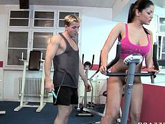 Kinky fitness instructor toys ass hole of one sextractive busty client. He thrust beaded dildo toy in her welcoming ass hole while she runs on a track.