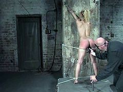 Cute fair-haired girl Isis Love is playing dirty games with some man in a cellar. The dude binds the cutie and pounds her vag with a dildo before whipping her amazing ass.