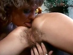 Naughty and insatiable lesbian pleases pussy of her tasty looking brunette girlfriend. She finger fucks her hairy punani and licks her big juicy clit.
