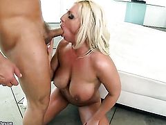 Blonde Sadie Swede with juicy knockers lets guy stick his meaty snake in her mouth