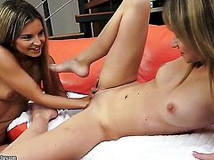 Brunette Angel Piaf and Suzie Carina kill time playing with each others vagina