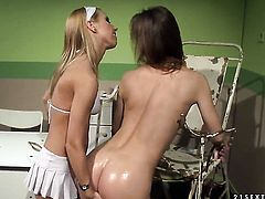 Blonde bombshell Nikky Thorne gives Melissa Sweets pussy a try in lesbian action