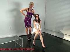 This blonde dominant shemale is tying up an innocent girl, touches her all over her body and fucks her ass.