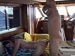 She strips out of her barely legal bathing suit, gets covered in oil, then works two cocks with her face and hands. Ride a big boat and a big cock!