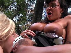 Famous one and only Lisa Ann with gigantic tits and arousing glasses makes out with submissive blonde Sara Vandella and makes eat her trimmed twat in awesome outdoor fantasy.