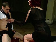 Redhead whore Madeline has a pair of long sexy legs. She loves to taunt men with her feet and Jake enjoys to be under such a slut's foot. He's tied on that chair and Madeline rubs his cock with her feet, having him at her complete control. Will she make him cum on her toes?