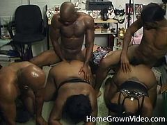 Two lustful Black chicks with huge asses and boobs suck big black cocks. Then they also get pounded from behind by three guys.