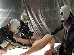 Nick Moretti, Tristan Jaxx and some more gays are having fun indoors. Three dominant dudes wearing gas masks bind their slave and poke toys into his asshole before fisting and fucking it brutally.