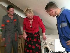 Granny Eva has problems with her washing machine and calls in for these guys. The boys think they will receive payment in money but Eva has other thoughts. She gives them something much better, her body. The old, saggy slut undresses and shows the boys her boobs. They put some cream on them and the fun begins!